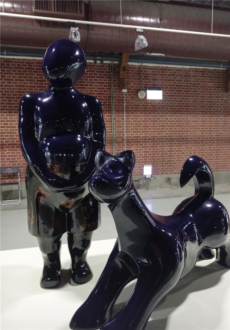 廖勝文脫胎漆藝作品-大叔與犬